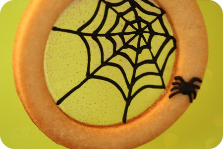 icing spiderweb halloween cookie