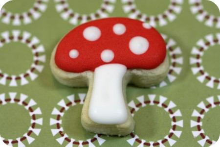 red and white decorated mushroom cookie