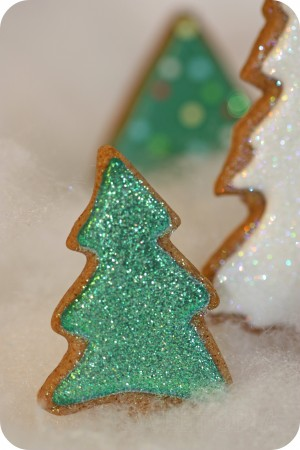 green decorated tree cookie with disco dust