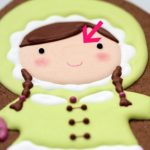 eskimo-girl-decorated-cookie-face-close-up-small-590x393