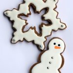 white snowflake and snowman decorated cookie small