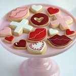 valentine decorated cookies on cake tier