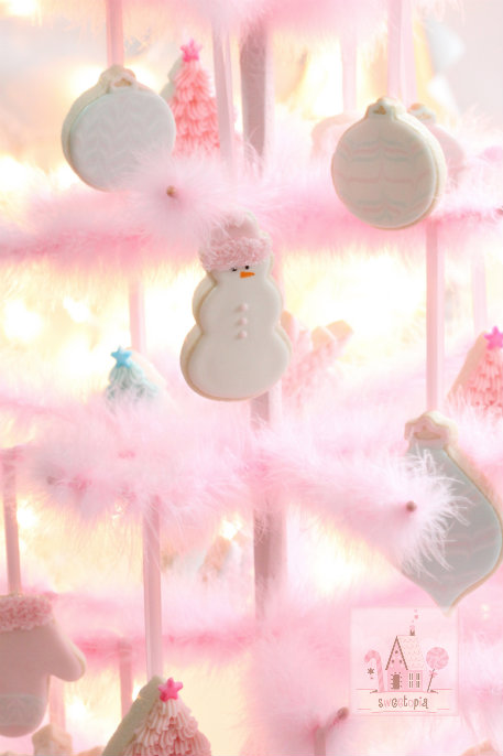 A Pink Feather Tree Is Decorated With Pretty Pastel Sugar Cookies Suspended  From The Tree With Thin Pale Pink Ribbons. The Effect Is Nothing Less Than  ...