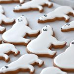 decorating gingerbread polar bear cookies with icing