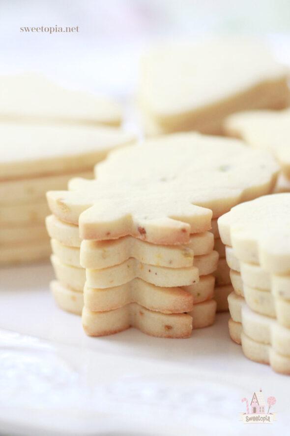This image has an empty alt attribute; its file name is Lemon-Pistachio-Cut-Out-Cookies-590x885.jpg